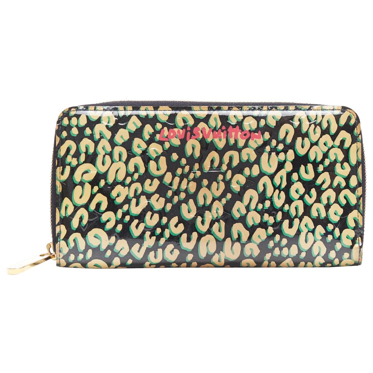 Louis Vuitton - Portefeuille Zippy pour femme en cuir verni - vert
