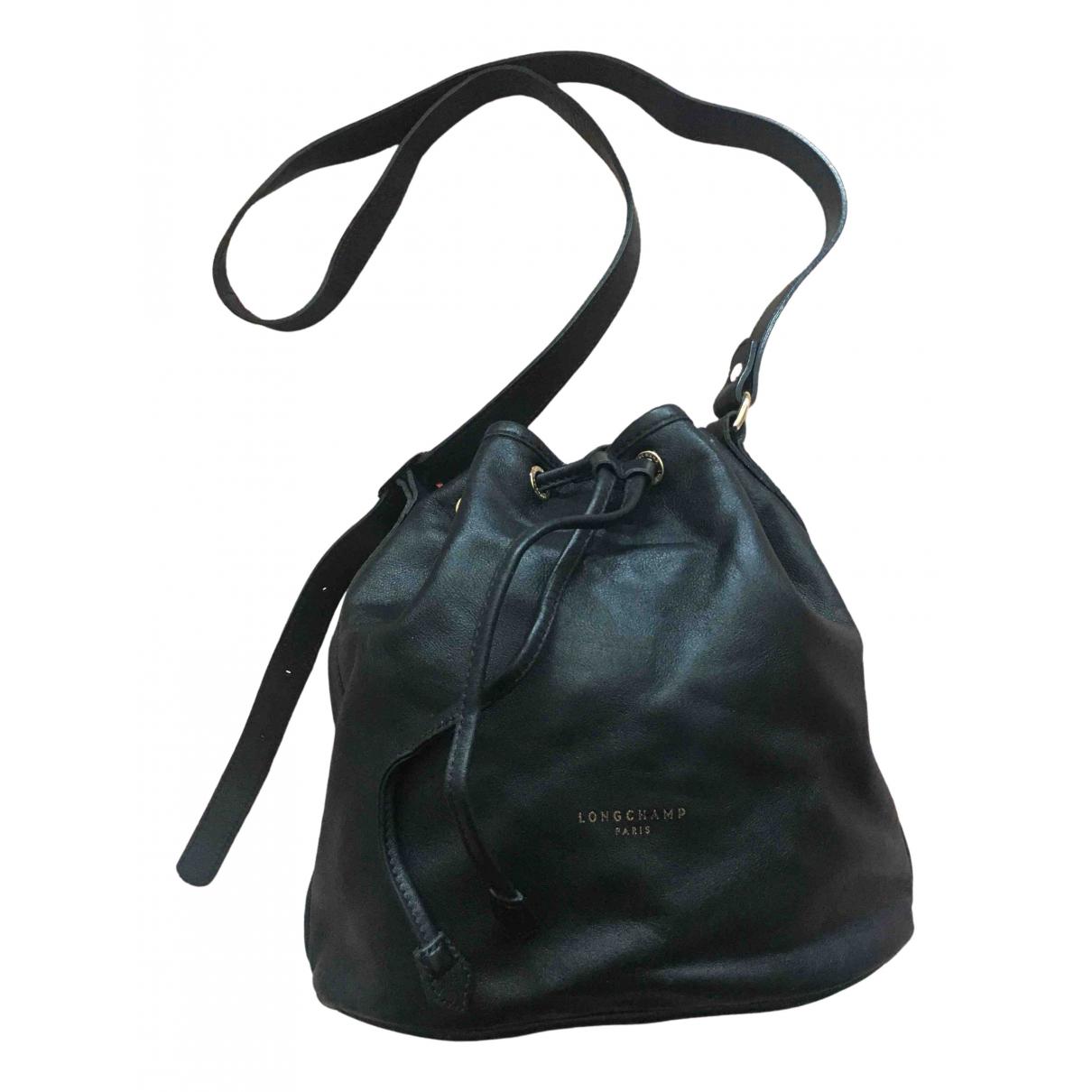 Longchamp \N Black Leather Clutch bag for Women \N