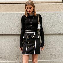 falda tweed con botones unida en contraste