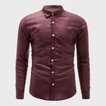 Einfarbiges Hemd mit Knopfen vorn