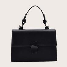 Bolso cartera con solapa minimalista