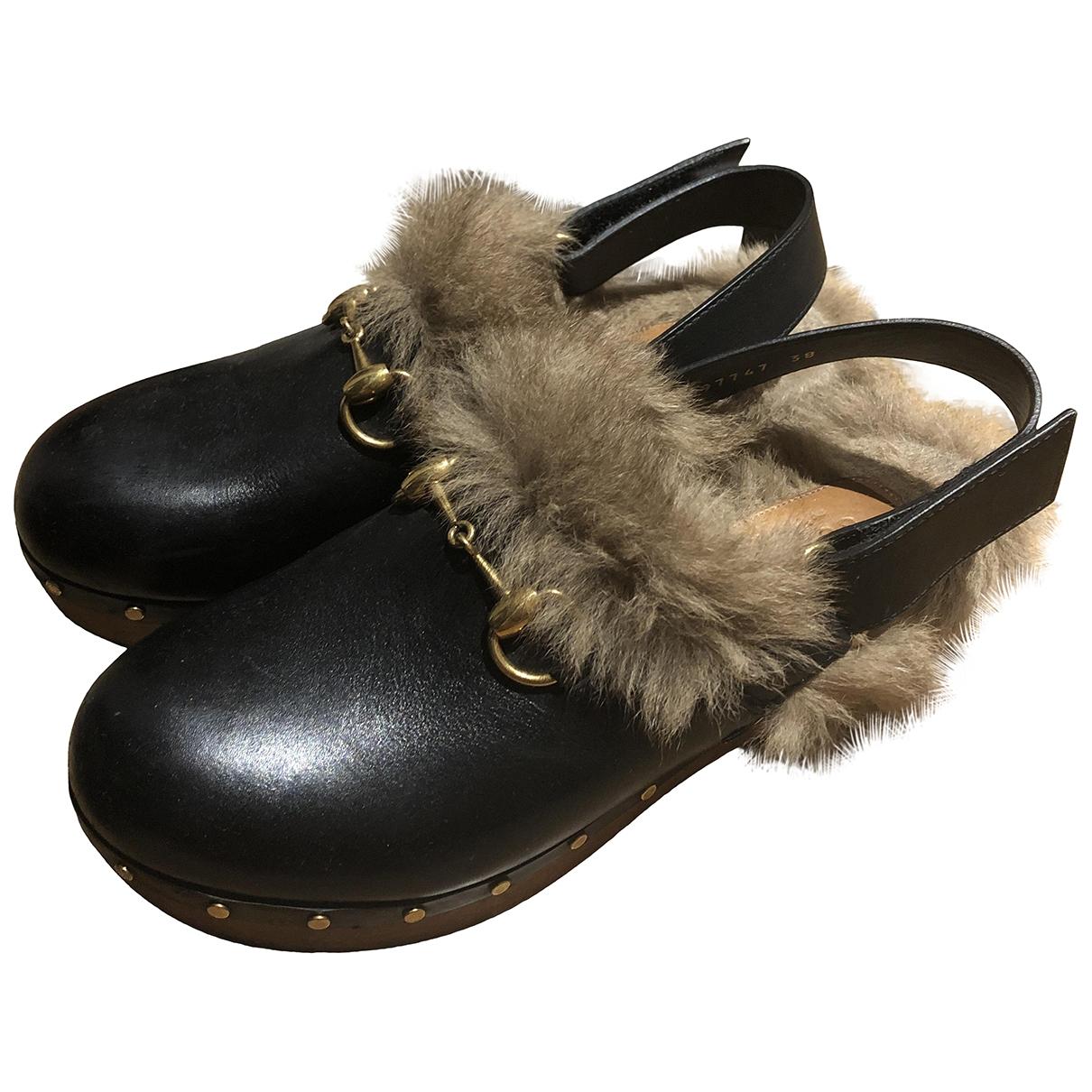 Gucci - Sabots   pour femme en cuir - noir