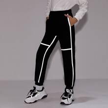Jogginghose mit reflektierendem Band und Taschen vorn
