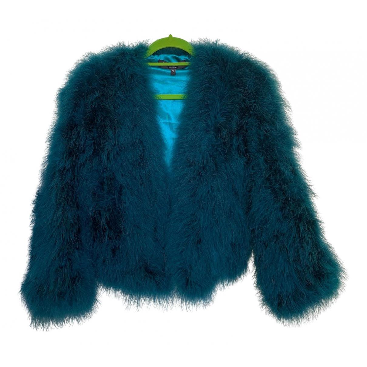 - Manteau   pour femme en fourrure - turquoise