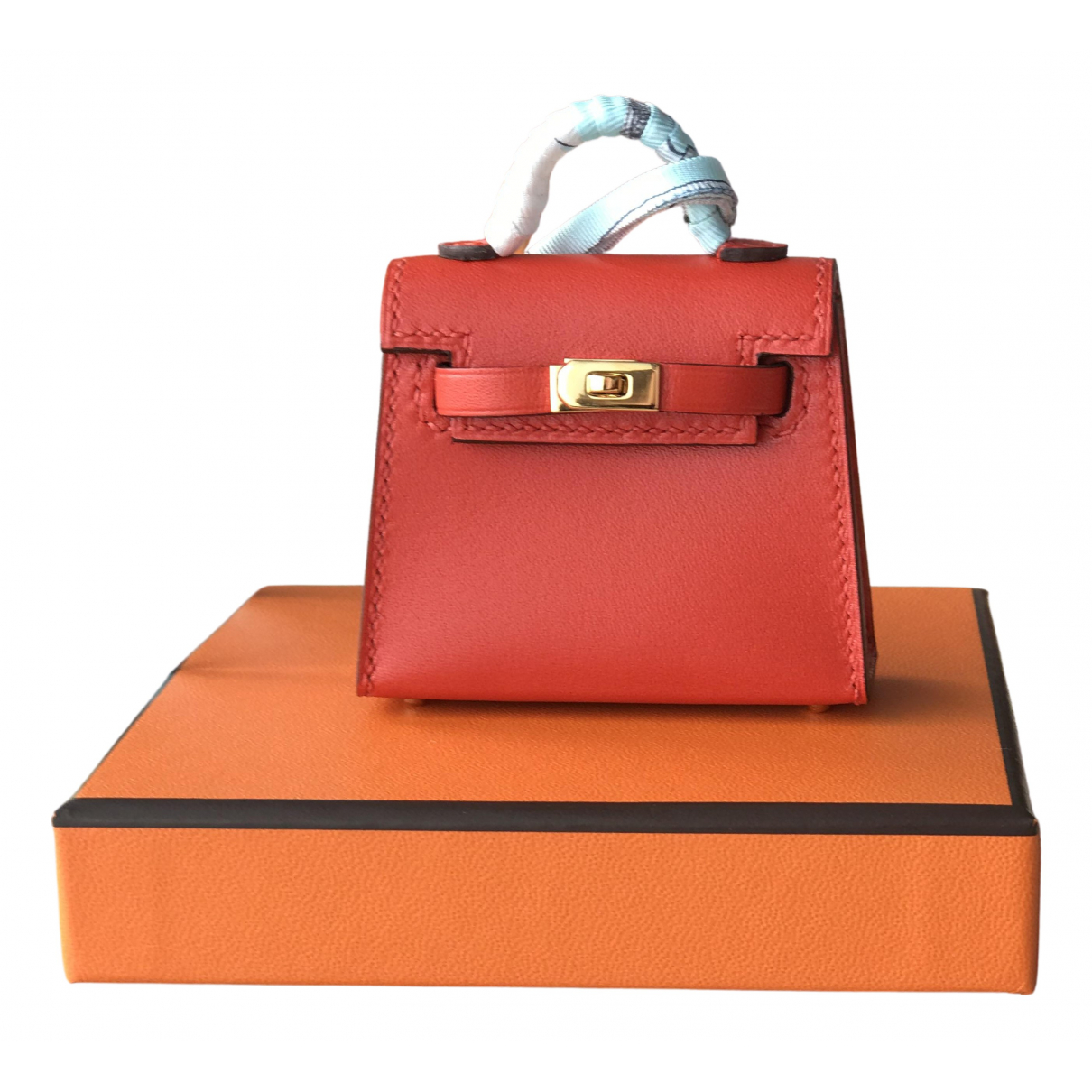 Hermes Kelly twilly charm Taschenschmuck in  Orange Leder