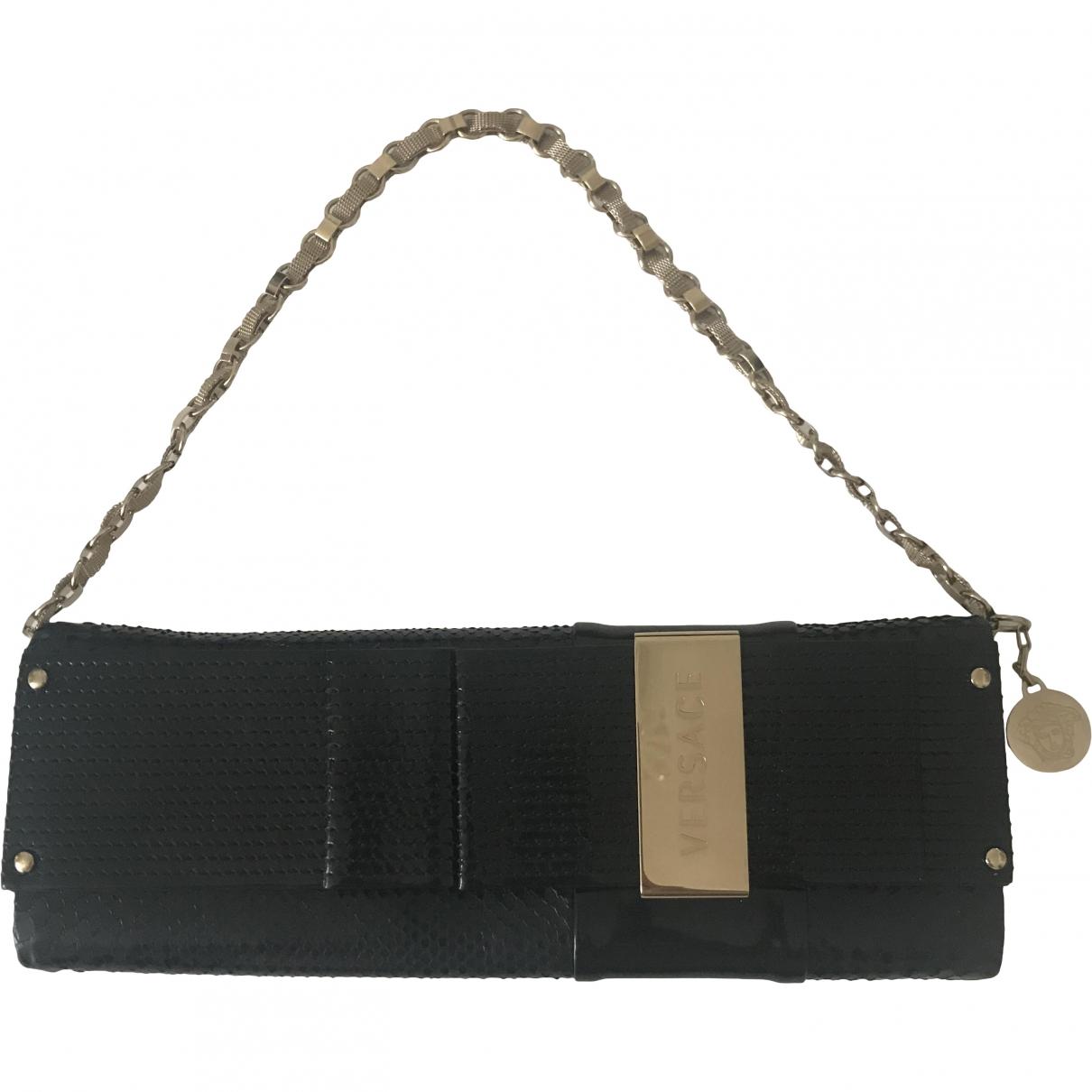 Versace \N Clutch in  Schwarz Lackleder