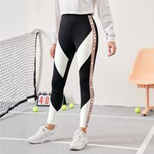 Leggings de color combinado con costura lateral con letra en contraste