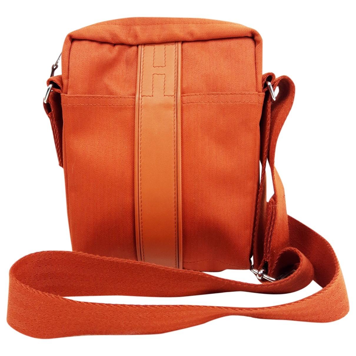 Hermès \N Orange Cloth bag for Men \N