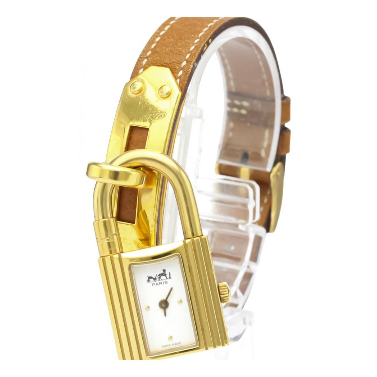 Hermes Kelly Uhr in  Weiss Vergoldet