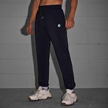 Athletische Hose mit Buchstaben Grafik
