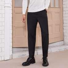 Pantalones unicolor de cintura con cordon