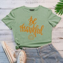 Camiseta con estampado de calabaza y slogan