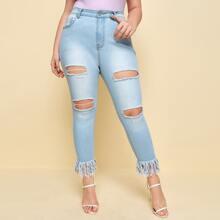 Skinny Jeans mit hoher Dehnung und Fransen am Saum