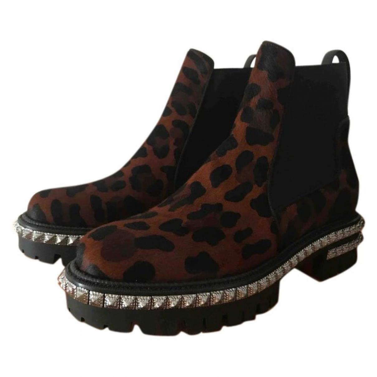 Christian Louboutin - Boots   pour femme en veau facon poulain - marron