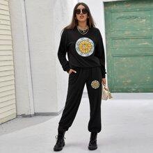 Sweatshirt mit Sonne & Mund Muster und sehr tief angesetzter Schulterpartie & Hose mit schraegen Taschen Set
