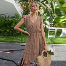 Kleid mit ueberallem Muster und Schosschen am Saum