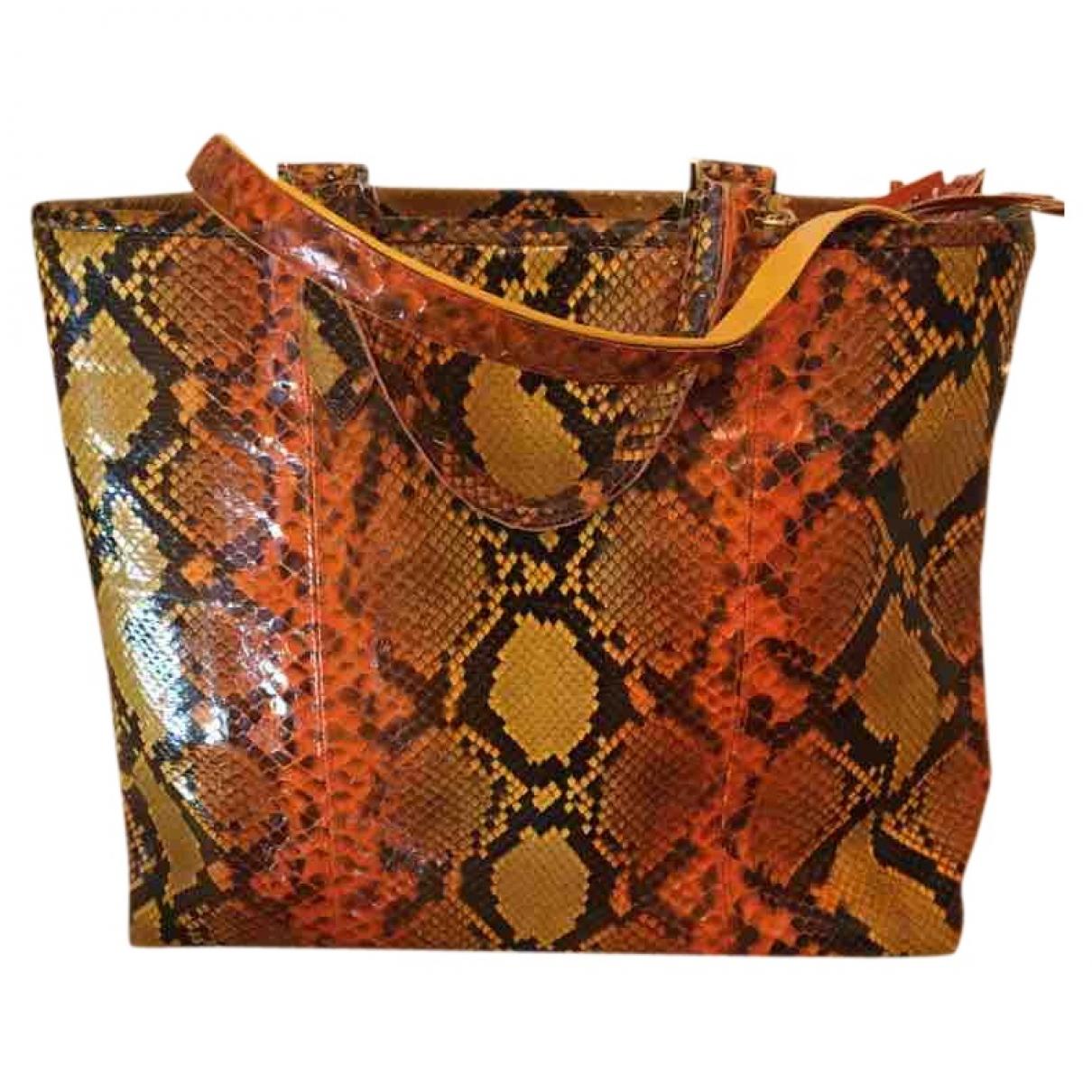 Non Signé / Unsigned \N Orange Python handbag for Women \N