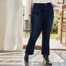Jeans mit Taschen Flicken und ausgestelltem Beinschnitt