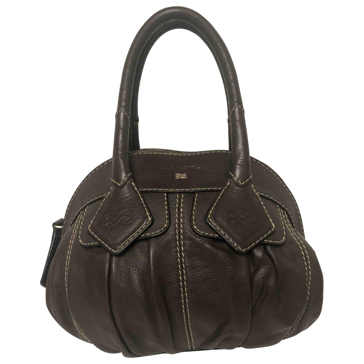 Lancel Gousset Handtasche in  Braun Leder