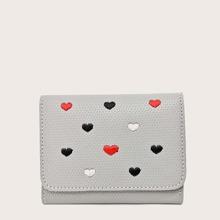 Monedero doblado de niñas con bordado de corazon