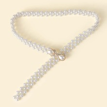 Cinturon con cuenta con perla artificial