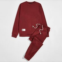 Conjunto pullover con parche con joggers de cintura con cordon