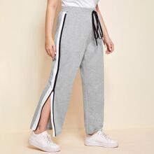 Pantalones con costura lateral en contraste con cremallera de cintura con nudo