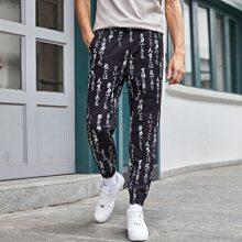 Pantalones con bolsillo con letra