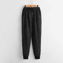 Pantalones con bolsillo oblicuo