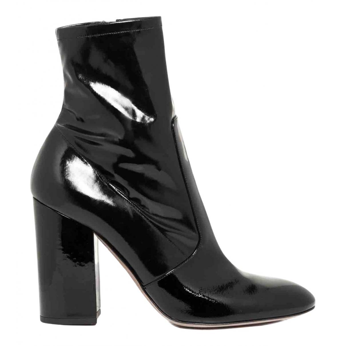 Valentino Garavani - Bottes   pour femme en cuir verni - noir
