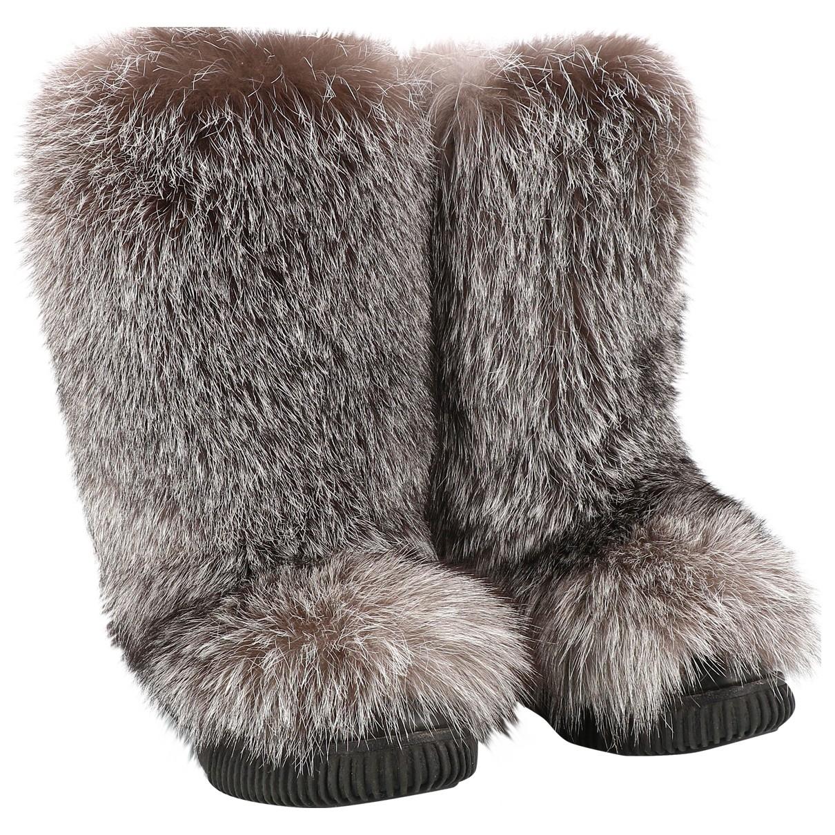 Moncler - Boots   pour femme en fourrure - beige