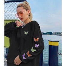 Sweatshirt mit Schmetterling Stickereien und sehr tief angesetzter Schulterpartie