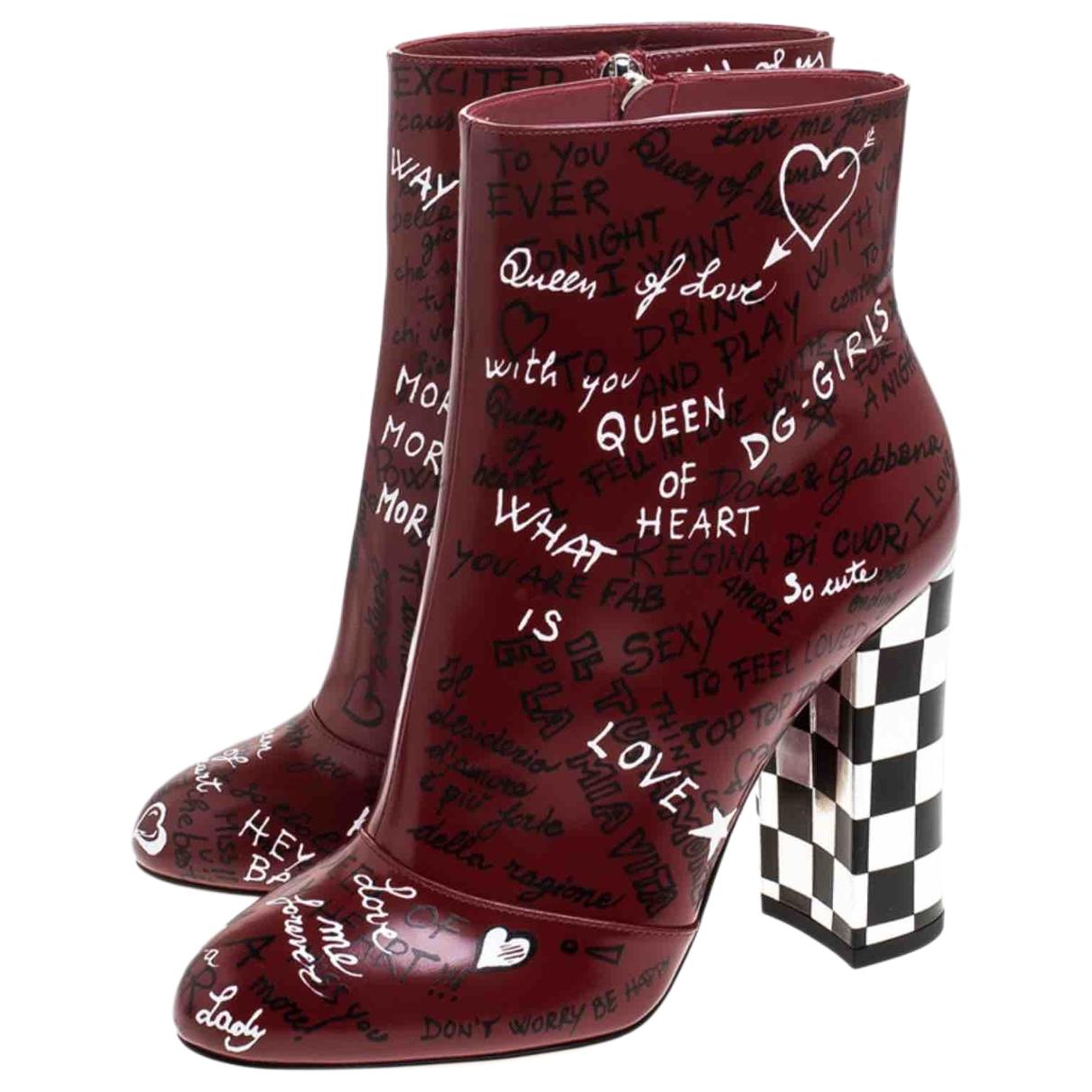 Dolce & Gabbana - Boots   pour femme en cuir verni - bordeaux