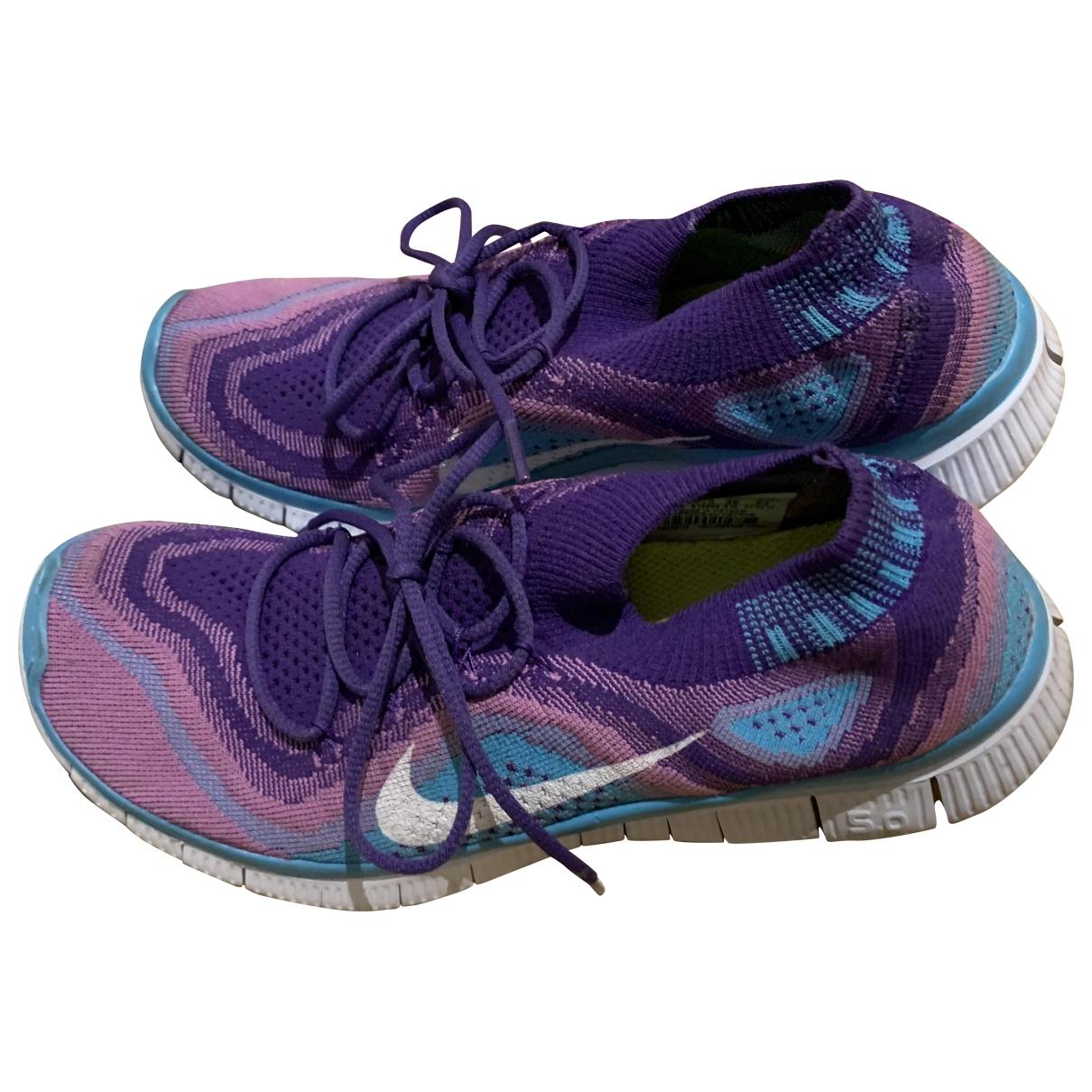 Nike - Baskets Free Run pour femme en toile - bleu
