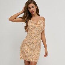 rueckenfreies Kleid mit Kreuzgurt, Raffungsaum und Gaensebluemchen Muster