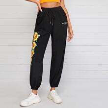 Jogginghose mit Buchstaben und Sonnenblumen Muster und Kordelzug auf Taille