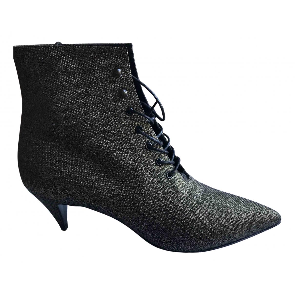 Saint Laurent - Boots Charlotte pour femme en cuir - dore