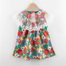 Kleid mit Blumen Muster, Stickereien und Netzstoff