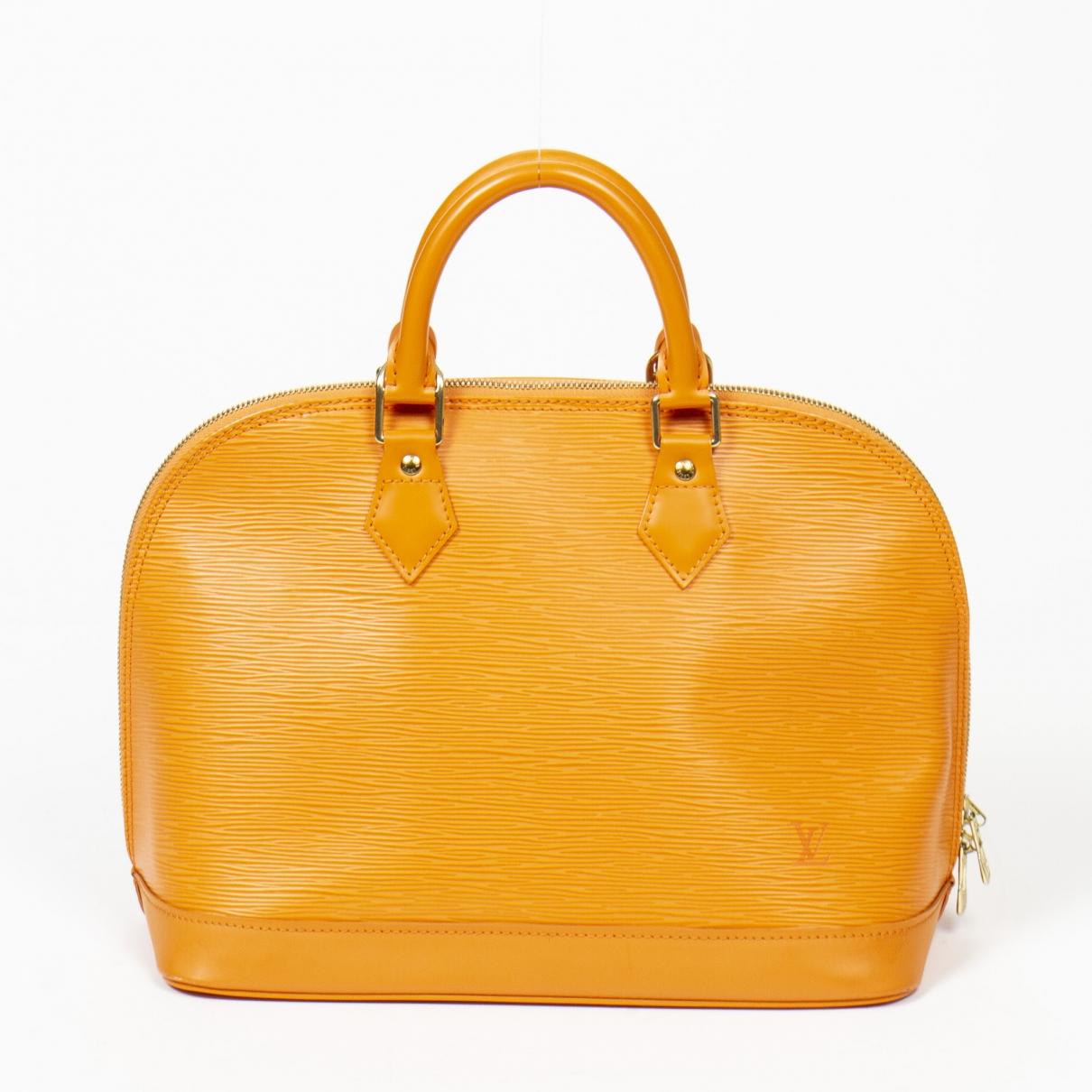 Louis Vuitton Alma Handtasche in  Gelb Leder