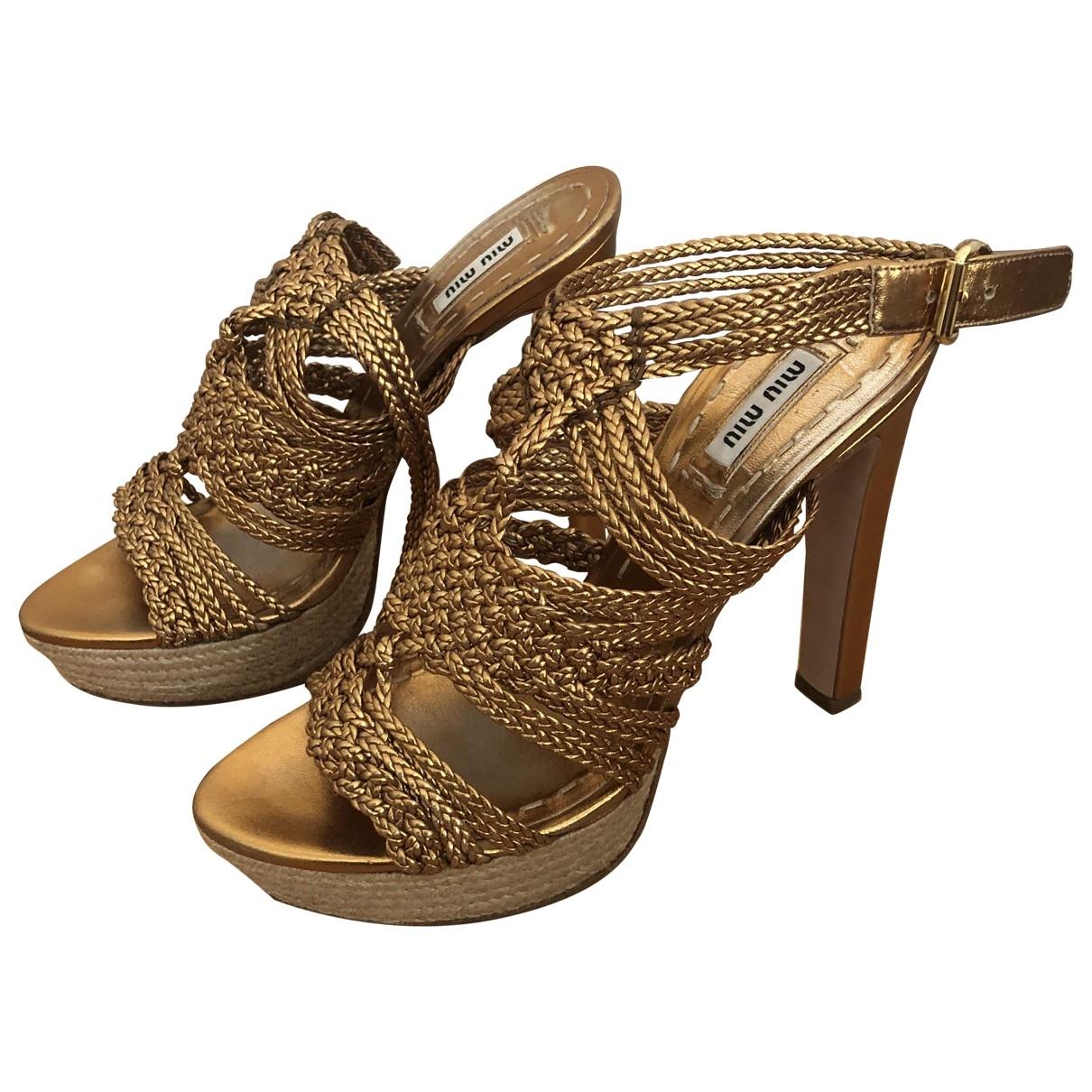Miu Miu \N Gold Leather Sandals for Women 38 EU