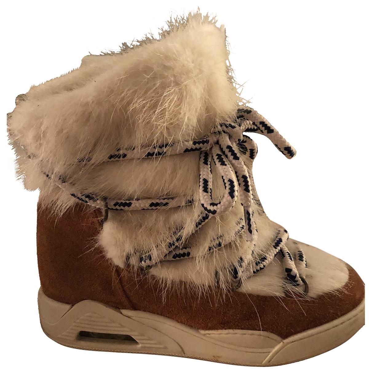 Serafini - Boots   pour femme en fourrure - blanc