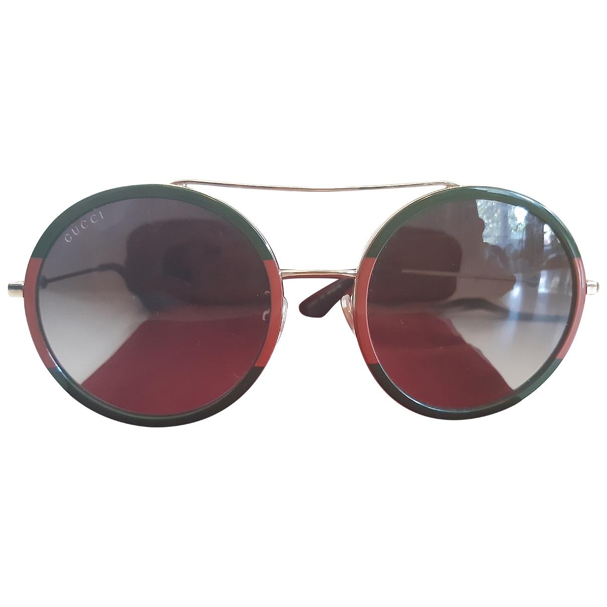 Gucci \N Sonnenbrillen in  Gruen Metall