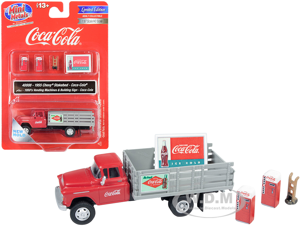 1955 Chevrolet Stakebed Truck Red and Gray with 1950s Two Vending Machines Hand Truck and Building Sign