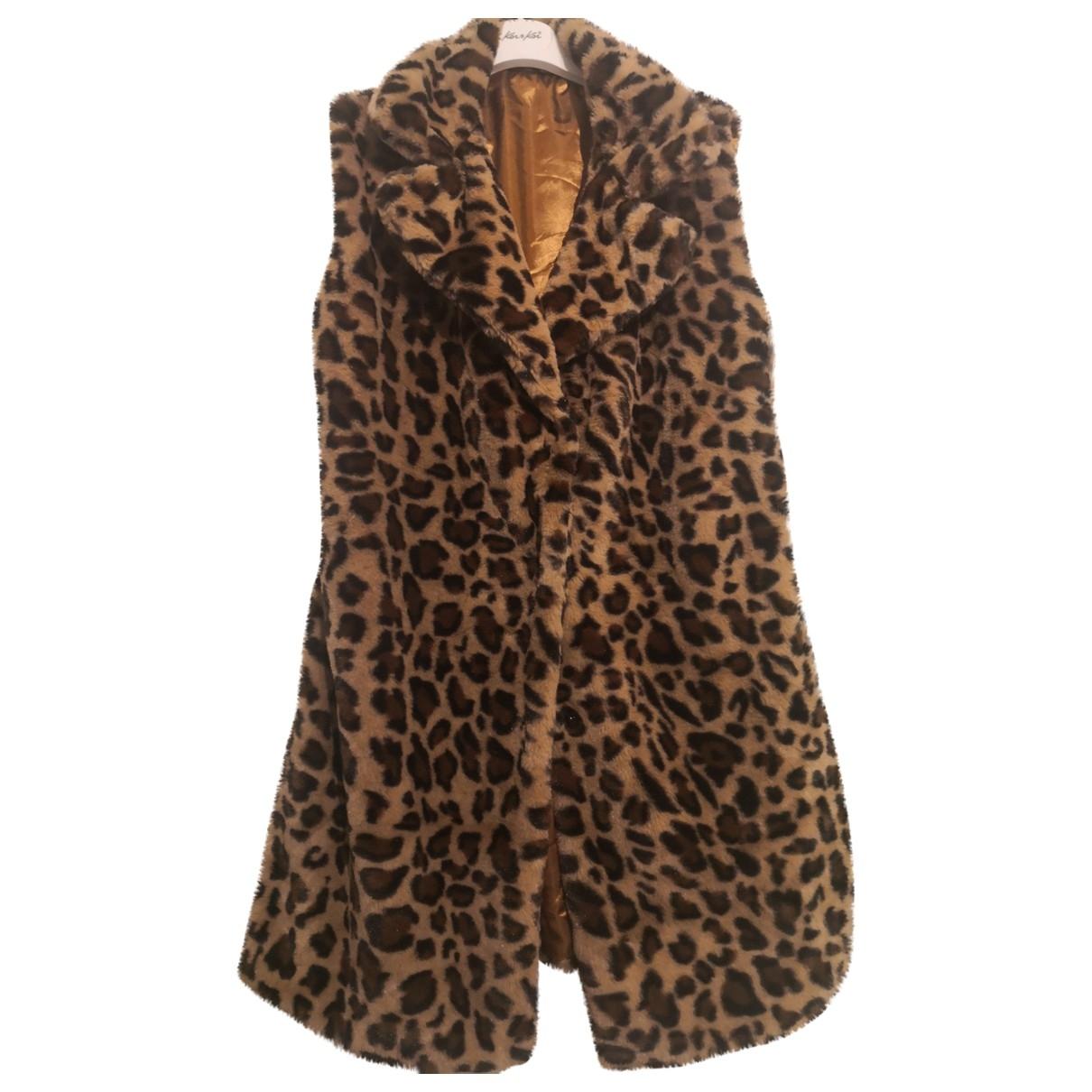 - Manteau   pour femme en fourrure synthetique