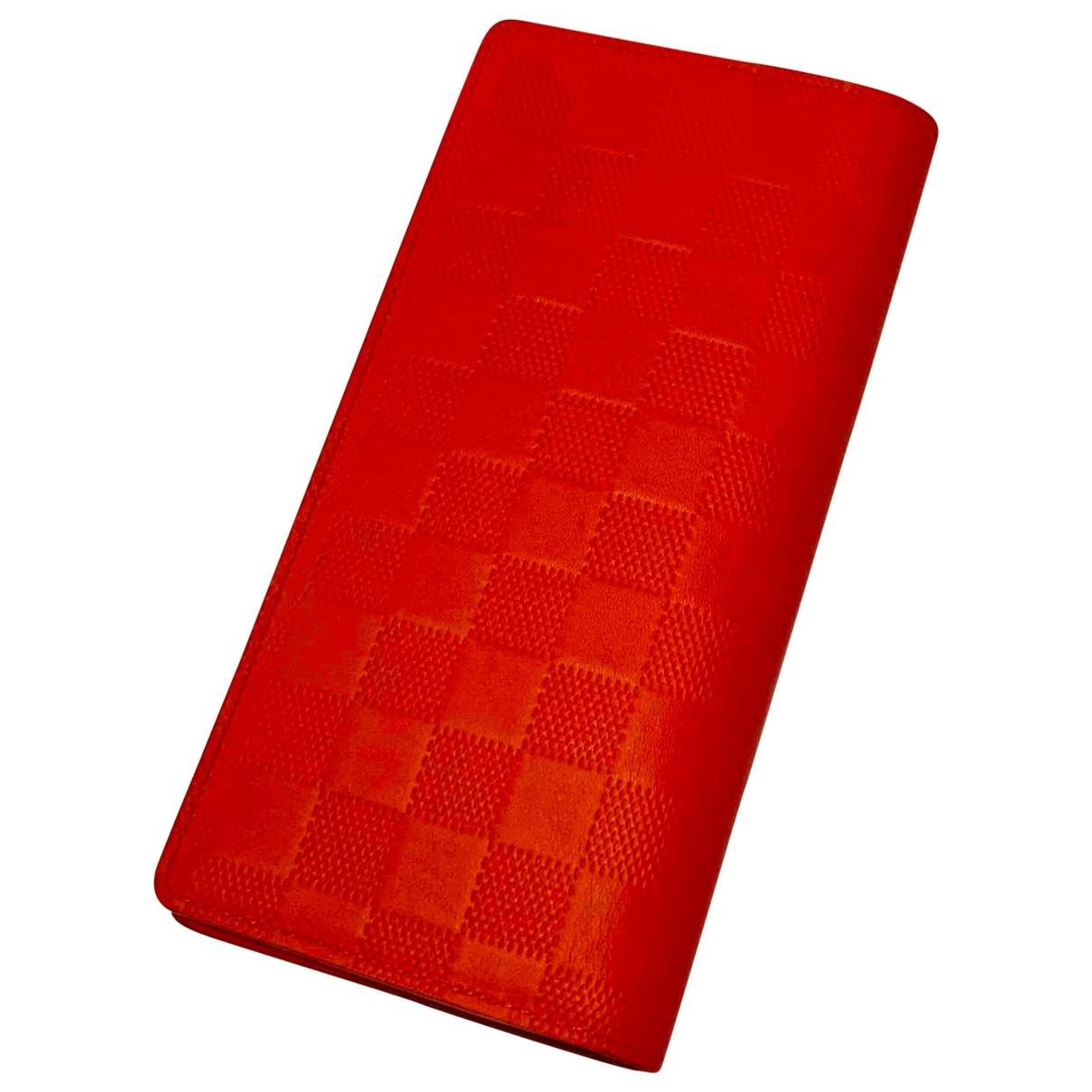 Louis Vuitton - Petite maroquinerie Brazza pour homme en cuir - orange