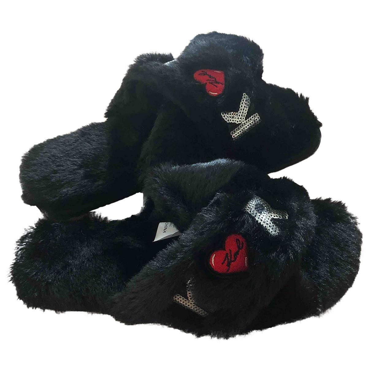 Karl Lagerfeld - Sabots   pour femme en fourrure synthetique - noir