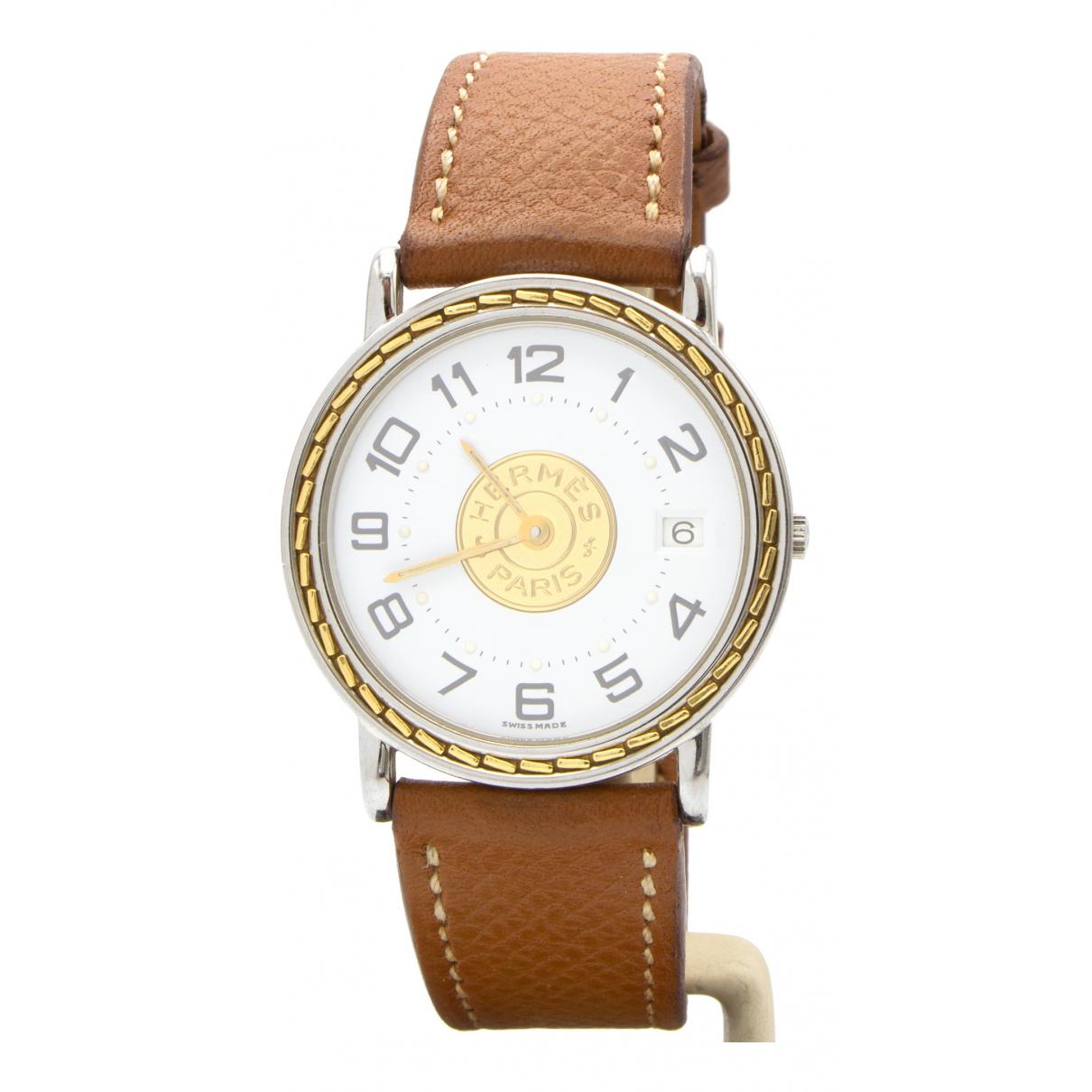 Hermes Sellier Uhr in  Silber Gold und Stahl