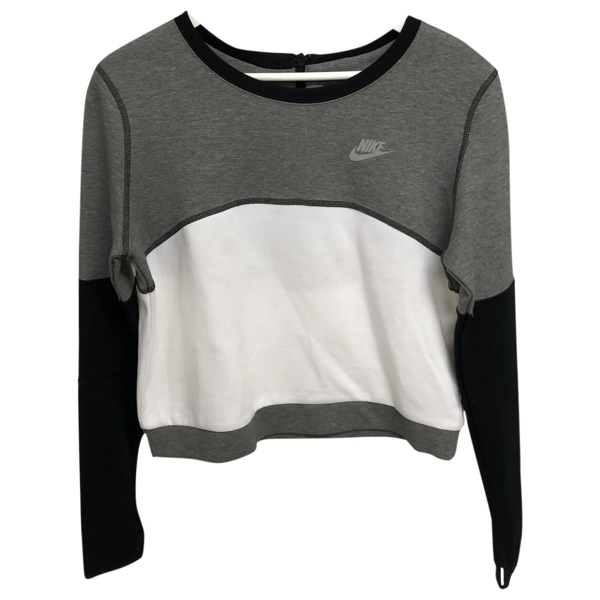 Nike - Pull   pour femme en coton - gris