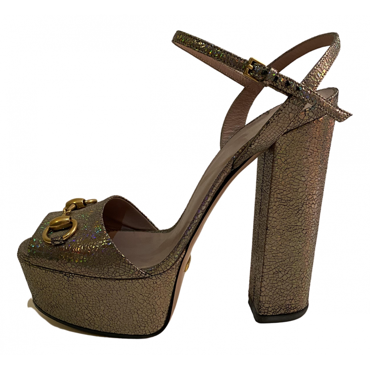 Gucci \N Sandalen in  Metallic Leder