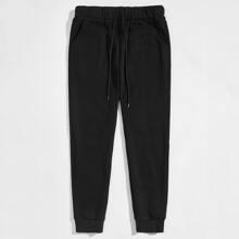 Pantalones deportivos de cintura con cordon unicolor